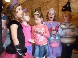 More pretty little princesses enjoy a story.