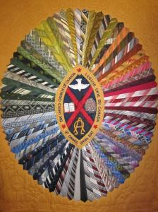 This quilt originated during a fundraising campaign for the Exeter United Church. Men in the church were challenged to donate a tie and then the women in the church put the pattern together. This quilt hangs in the church sanctuary.