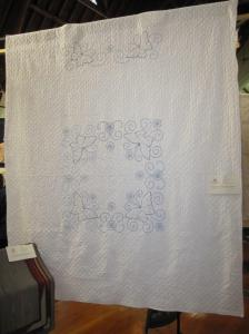 This quilt is stitched with French knots and is over 100 years old. The knotting is a very intricate technique.