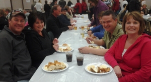 Greg and Cheryl Becker, front and Carolyn and Peter Mathoni enjoy the Zurich Lion's Fish Fry