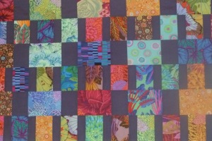 Wendy's 'modern' quilt features bright colours and squares or rectangles.