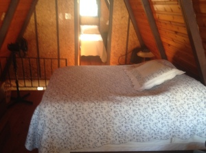 Sleeps Six:  two regular beds in separate rooms in the loft area, and a queen size pull-out in the Living room.