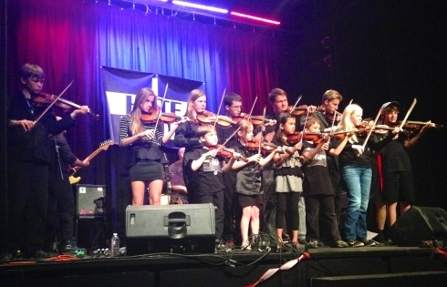 Cappy Onn's violin school kicking off their set.