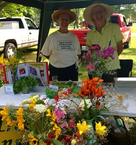 Pat McDougall and Shelagh Sully pose for a shot with their fresh cut flowers. Coventree Gardens is known as the home of Bayfield lilies.