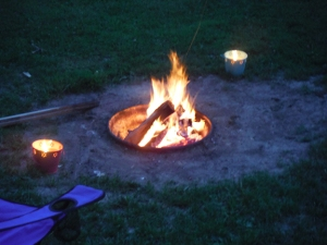 Camping requires a roaring fire to sit around, doesn't it?