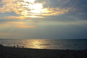The waters of Grand Bend shining at sunset.