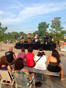 The Stegall sisters performing at Summer Sunset Sounds for a crowd of beach go-ers.