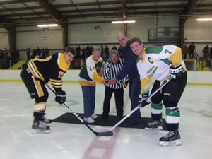 Joyce and Marg McClure along with Ben Lobb drop the first puck with Centenaires captain Brendon Merritt and Drives captain Dan Rhames (photo courtesy of Dave Scott)