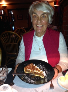 Polly looking pleased about her pecan flan.
