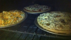 The pizza, par cooked in a wood oven, is finished at a high temperature. Photos by James Eddington.