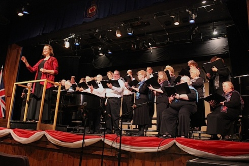 Artist Director Sharon Poelstra invites the audience to join Blyth Festival Singers in singing The Maple Leaf Forever.