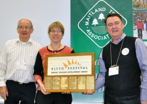 Roger Goddard and Suzanna Reid, of the Maitland Trail Association, accept the Tourism Development Award from John McHenry, an HTA board member.