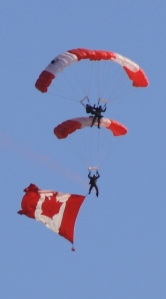 The SkyHawks, with their trademark Canadian flag parachutes, make their way to a landing at Goderich's beach.