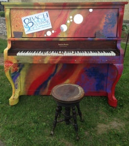This piano originally belonged to Diva Karen Stewart's grandmother's.  Karen donated it to Bach Music Festival in 2011 and an art class at South Huron District High School painted it.