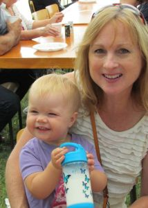 16-month-old Brinley from Zurich enjoys breakfast with her grandmother.