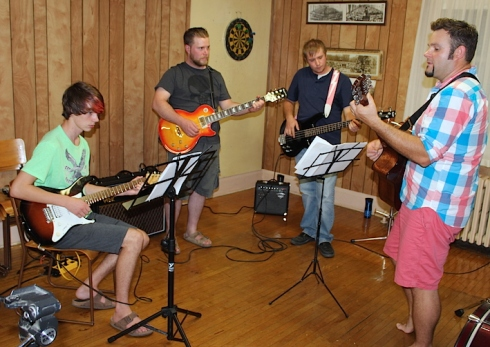 Adam Cyr, at right, jams with students James Alcock, David Mackechnie and Aaron Neeb in Rock and Roll Band Camp.