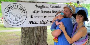 Festival organizers Ryan Somers, Jen Reaburn and their eight-week-old daughter, River.